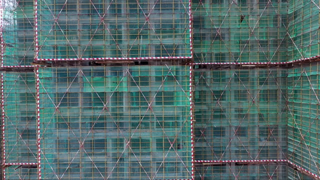 construction sites with green net protected - scaffolding stock videos and b-roll footage