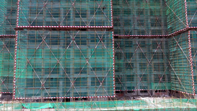 construction sites with green net protected - netting stock videos & royalty-free footage
