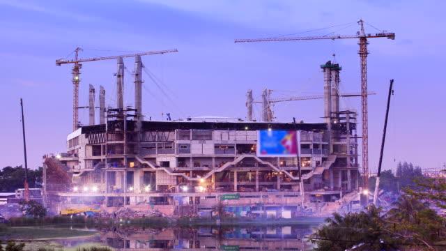 Construction stadium site with crane building,Time lapse