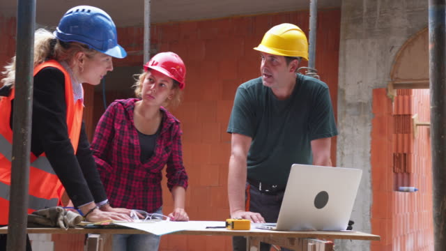 construction team going through plans - construction worker stock videos & royalty-free footage