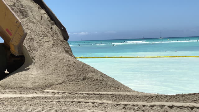 construction to widen beach with sand due to global warming sea level rise erosion in waikiki, honolulu, oahu, hawaii. - slow motion - eroded stock videos & royalty-free footage