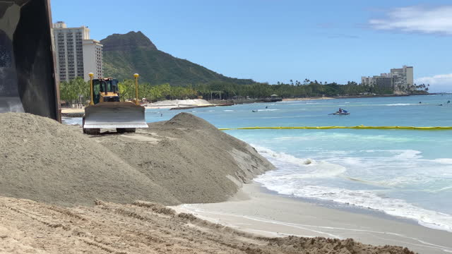 construction to widen beach with sand to combat sea level rise erosion in waikiki, honolulu, oahu, hawaii. - eroded stock videos & royalty-free footage