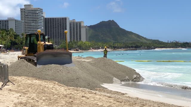 construction to widen beach with sand to combat sea level rise erosion in waikiki, honolulu, oahu, hawaii. - construction vehicle stock videos & royalty-free footage