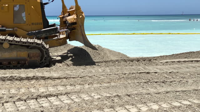construction to widen beach with sand to combat sea level rise erosion. - eroded stock videos & royalty-free footage
