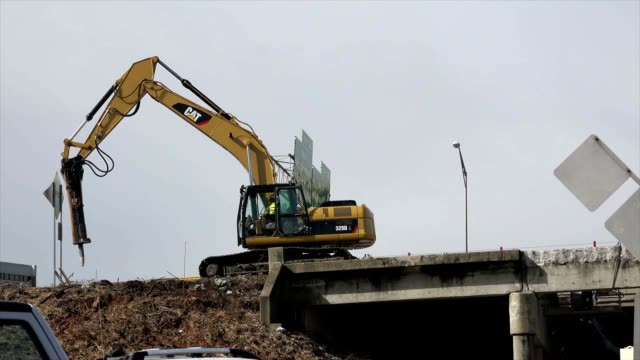 construction truck excavator caterpillar - roadworks stock videos & royalty-free footage