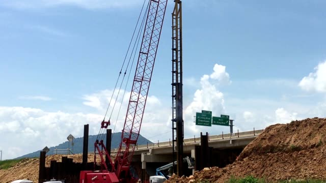 construction truck strengthening the road foundation - pile driver stock videos and b-roll footage