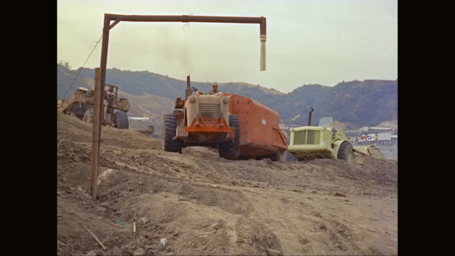 ws construction vehicle moving at construction site / united states - 1960 stock videos & royalty-free footage