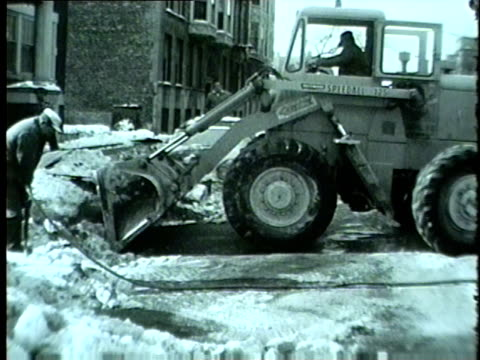 wgn construction vehicle pushes snow on winter day in chicago in 1962 - anno 1962 video stock e b–roll