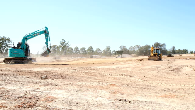 Construction vehicles are seen undertaking development work for a housing estate being built in the newly formed Sydney South West suburb of Bardia...