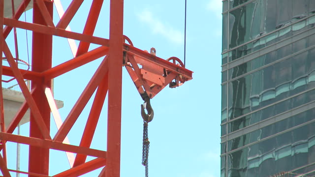 hd: construction - crane construction machinery stock videos & royalty-free footage