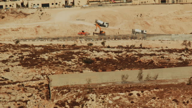 construction work of an israeli settlement in the west bank, seen from bethlehem. - apartheid stock videos & royalty-free footage