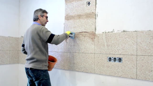 construction work with ceramic tiles. - ukrainian ethnicity stock videos and b-roll footage