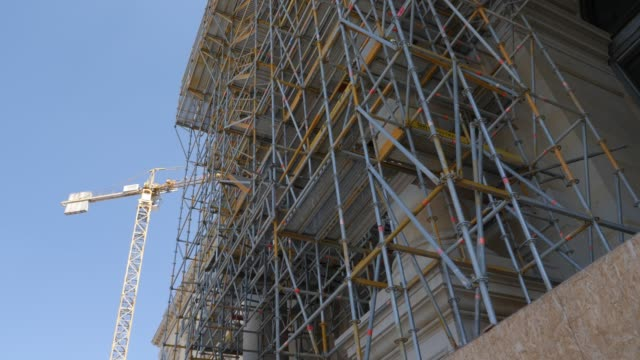 construction work with construction site scaffolding in front of the reconstructed baroque facade of the humboldt forum stands on june 17 2019 in... - berliner stadtschloss stock-videos und b-roll-filmmaterial
