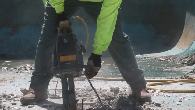 construction worker alex hernandez uses a jackhammer to demolish a swimming pool at an apartment complex on april 8 2015 in hayward california as... - pneumatic drill stock videos & royalty-free footage