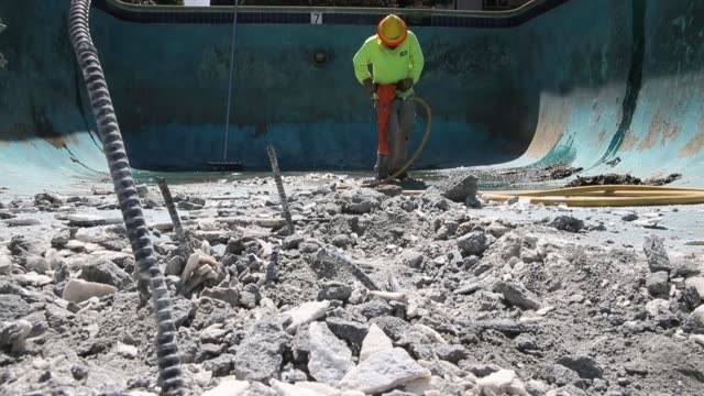construction worker alex hernandez uses a jackhammer to demolish a swimming pool at an apartment complex on april 8 2015 in hayward california as... - justin hayward stock videos and b-roll footage
