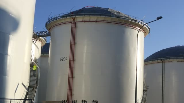 a construction worker assembles the roof of a fuel storage tank at the vttv oil storage terminal a joint venture of vitol group and misc bhd in... - fuel storage tank stock videos and b-roll footage