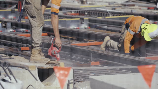 construction worker blowing away dirt - construction site stock videos & royalty-free footage