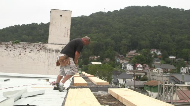 vídeos de stock, filmes e b-roll de construction worker building in williamson west virginia - appalachia