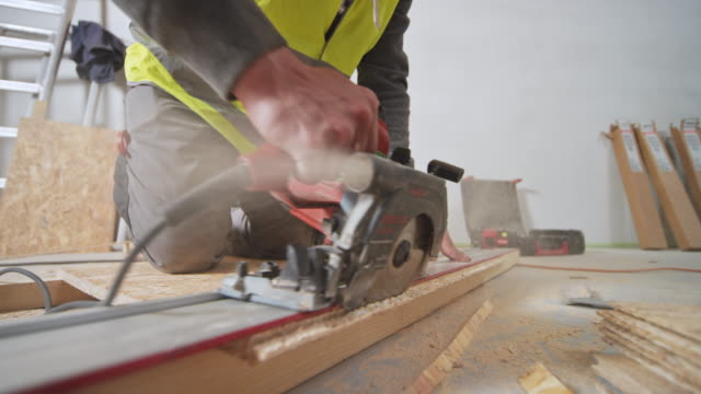 ld construction worker cutting a chipboard - insulator stock videos & royalty-free footage