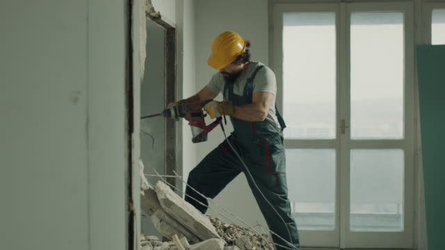 construction worker demolishing the wall with electric drill - drill stock videos & royalty-free footage