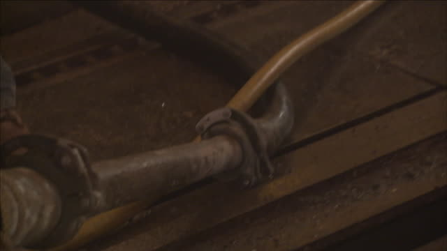 a construction worker hammers a clamp onto a hose. - clamp stock videos & royalty-free footage