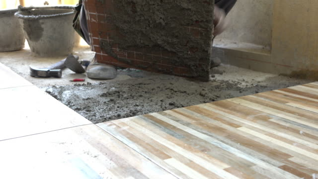 construction worker installing ceramic tiles floor - basement stock videos and b-roll footage