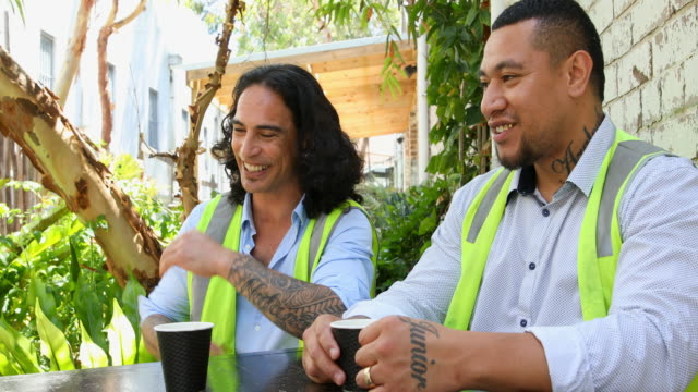 construction worker men in high vis vests having a coffee break - pacific islanders stock videos & royalty-free footage
