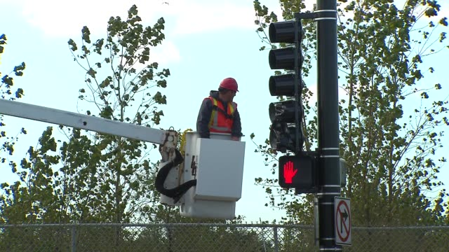 construction worker on cherry picker on october 14 2013 in chicago illinois - cherry picker stock videos & royalty-free footage