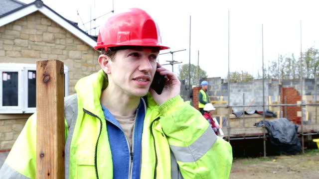 construction worker on the telephone - construction frame stock videos & royalty-free footage