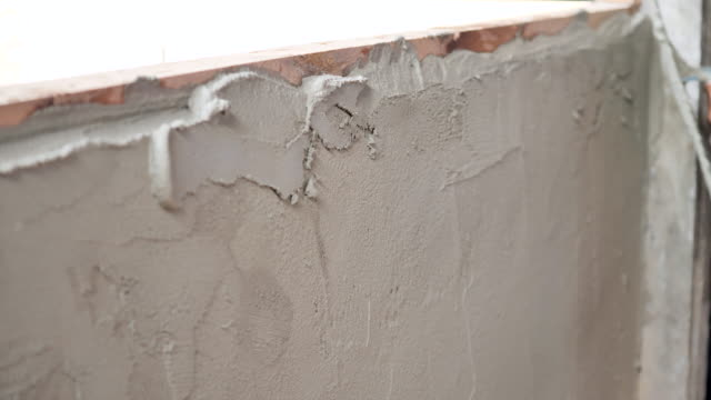 construction worker plaster cement wall - concrete wall stock videos & royalty-free footage