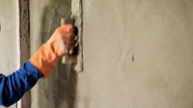 construction worker plaster cement wall - cement stock videos & royalty-free footage