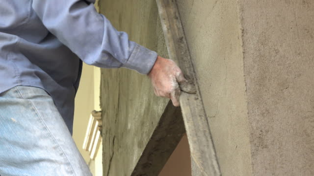 construction worker plaster cement wall - plaster stock videos and b-roll footage