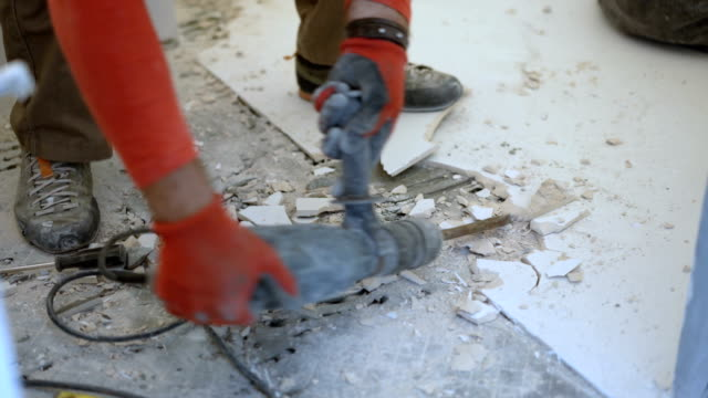 construction worker removing old tiles from bathroom floor - tile stock videos & royalty-free footage