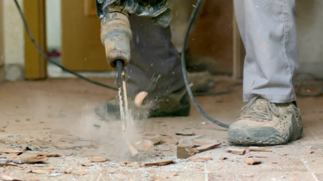 construction worker renovating, removing tiles with jackhammer, slow motion - tile stock videos & royalty-free footage