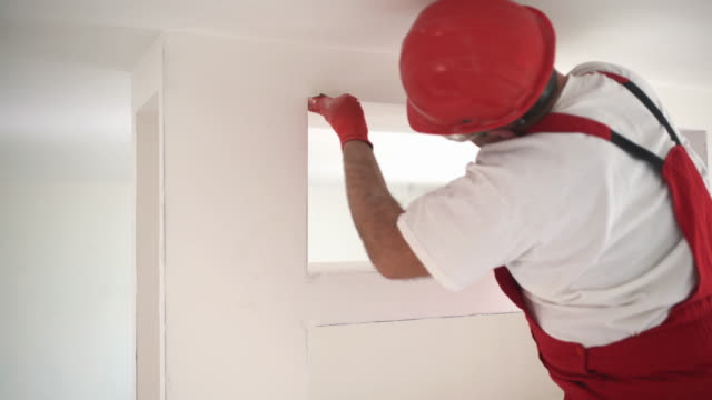 construction worker sanding a drywall. - wallpaper stripper stock videos and b-roll footage