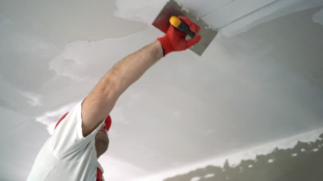 construction worker sanding a drywall. - decorating stock videos & royalty-free footage