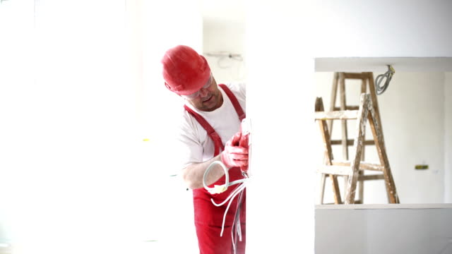 construction worker sanding a drywall. - repairman stock videos & royalty-free footage