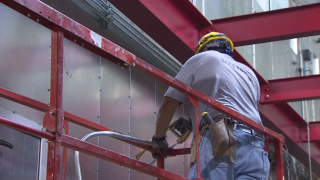 Construction Worker Sawing Small Pipe at Lurie Children's Hospital on June 11 2013 in Chicago Illinois
