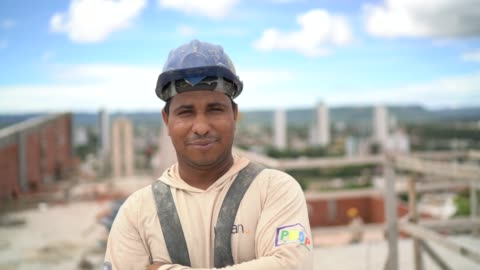 construction worker standing in a construction site - helmet stock videos & royalty-free footage