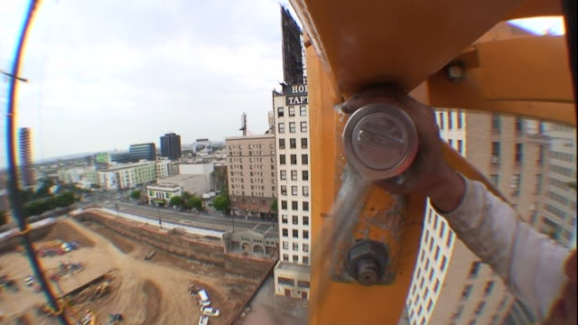 a construction worker tightens a large bolt with a socket wrench. - bolt stock videos & royalty-free footage