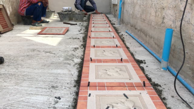 Construction worker tiling