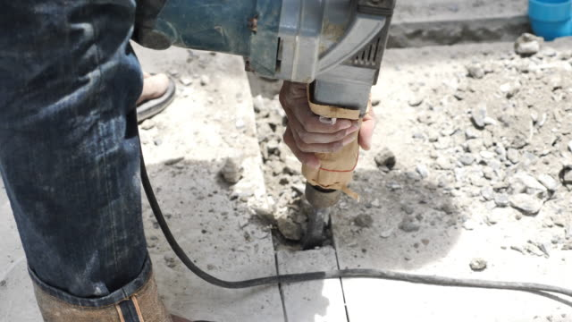 construction worker use jackhammer chisel drilling on the floor - wall building feature stock videos and b-roll footage