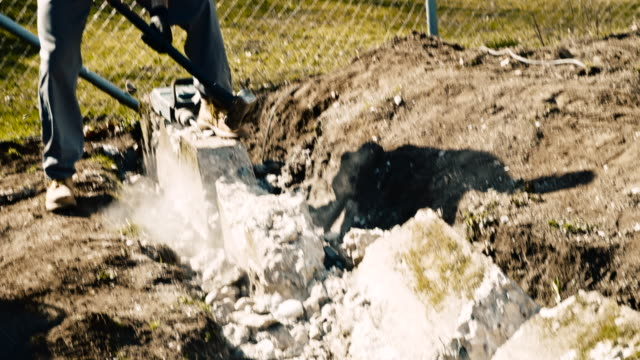 slo mo construction worker using a sledgehammer to strike a concrete block - strike industrial action stock videos & royalty-free footage