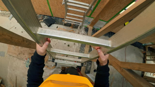 pov construction worker walking down the ladder at the construction site of a prefab wooden home - ladder stock videos and b-roll footage