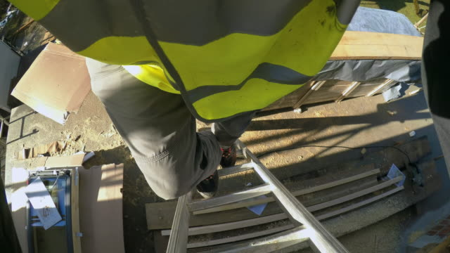 pov construction worker walking up a ladder - ladder stock videos & royalty-free footage