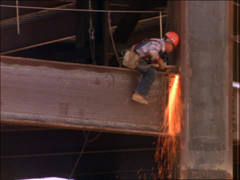 construction worker welding beams - solo uomini di età media video stock e b–roll