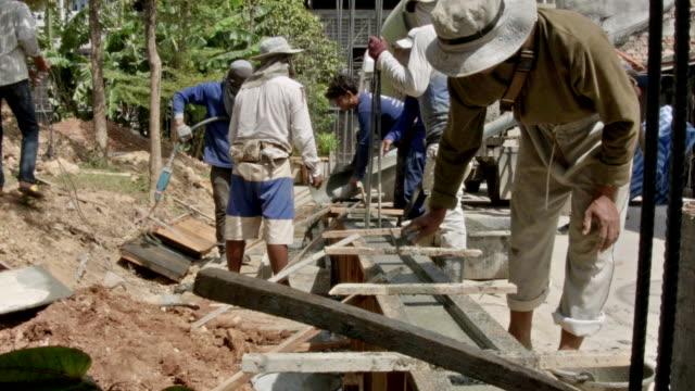 construction worker working - sidewalk gutter stock videos & royalty-free footage