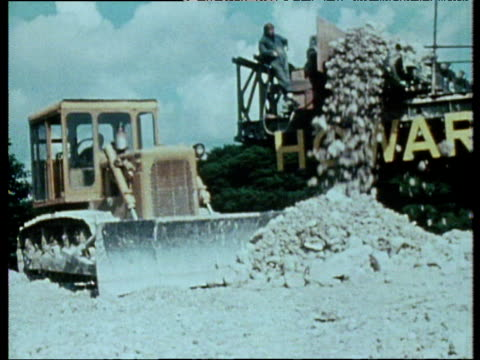 construction workers and machinery working on building new humber bridge; 1980s - 桁橋点の映像素材/bロール