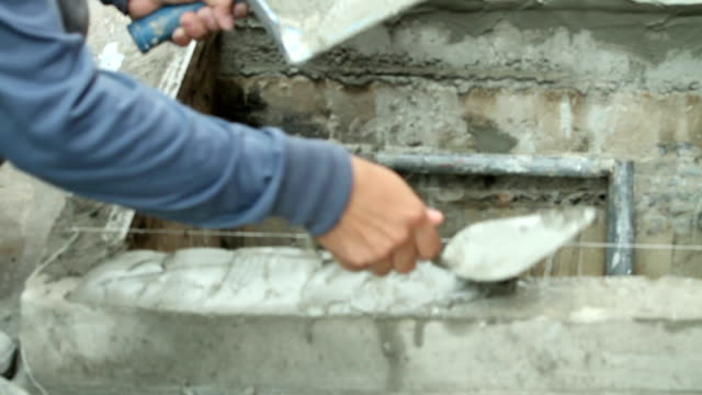 construction workers are plastering - plaster stock videos and b-roll footage