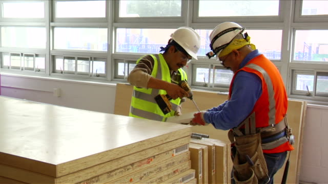 construction workers assemble doors on april 30 2012 in washington dc - power supply stock videos & royalty-free footage
